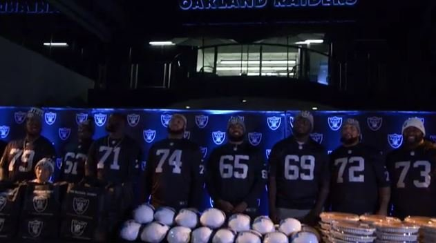 Screenshot of Raiders teammates passing out Thanksgiving Day meals to families in Oakland. (Courtesy: Raiders)