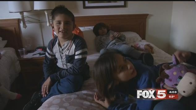 The Bont family children play together in a hotel room after losing their home in a fire (FOX5).