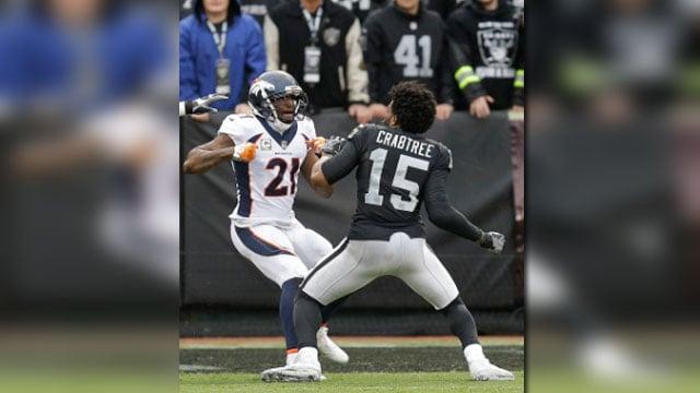 Denver Broncos cornerback Aqib Talib (21) fights Oakland Raiders wide receiver Michael Crabtree (15) during the first half of an NFL football game in Oakland, Calif., Sunday, Nov. 26, 2017. (AP Photo/Ben Margot)