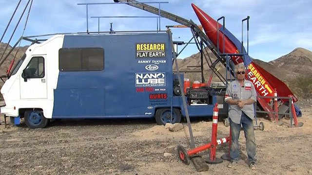 'Mad Mike' Hughes stands by his home-made rocket in the California desert (FOX5).