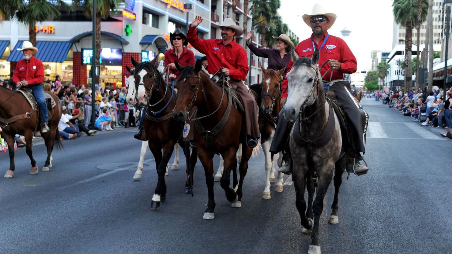 A group on horseback parades down the route of the Helldorado Parade. (City of Las Vegas)
