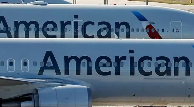 A pair of American Airlines jets are shown parked on the airport apron, Monday, Nov. 6, 2017, at Miami International Airport in Miami. (AP Photo/Wilfredo Lee)