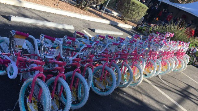 Donated bikes are lined up in the parking lot during the 2017 KLUC Toy Drive on Nov. 30, 2017. (Peter Dawson/FOX5)
