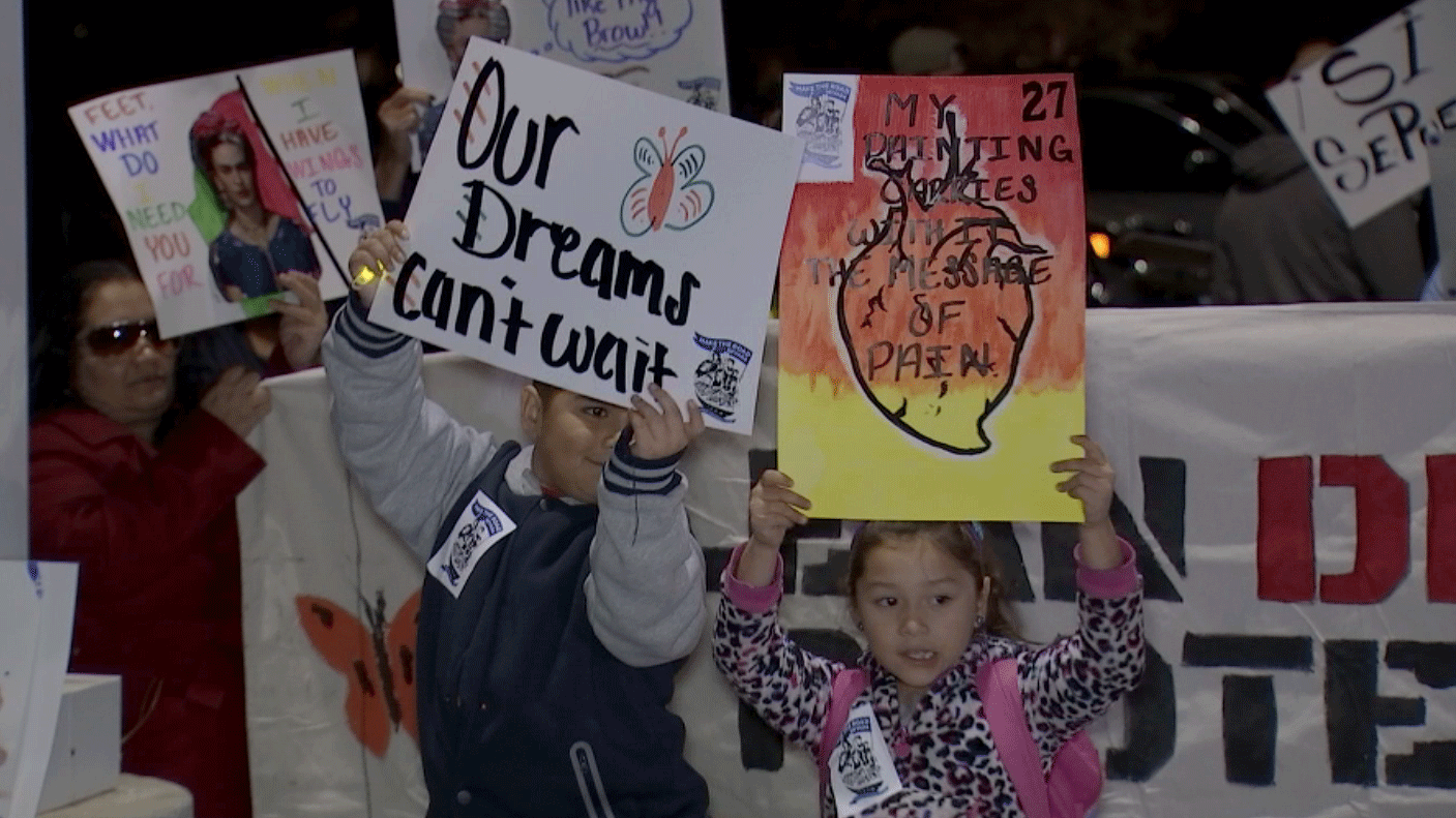 Children hold signs during a march in Las Vegas on Nov. 30, 2017. (Miguel Martinez-Valle/FOX5)
