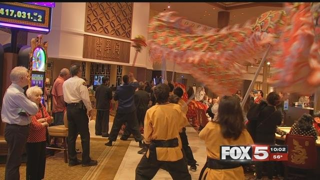 Performers dance with a dragon-themed decoration (FOX5).