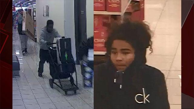 Surveillance stills show two suspects fleeing with merchandise (LVMPD / FOX5).
