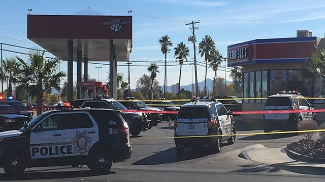 LVMPD officers investigate the scene of an officer-involved shooting at a west Las Vegas convenience store (FOX5).