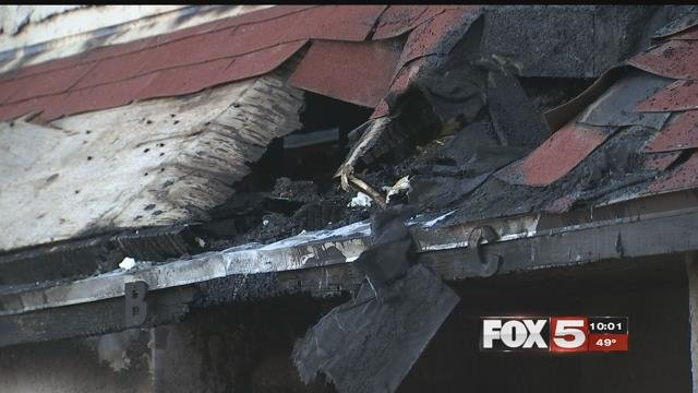A scorched and caved-in roof remains as proof of a devastating blaze that left 12 people without a home Dec. 10, 2017 (FOX5).