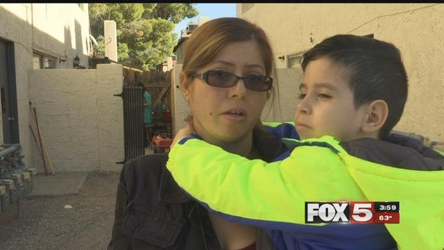 A mother had to throw her son out of a second-story window to escape an apartment fire in Las Vegas Sunday. (FOX5)
