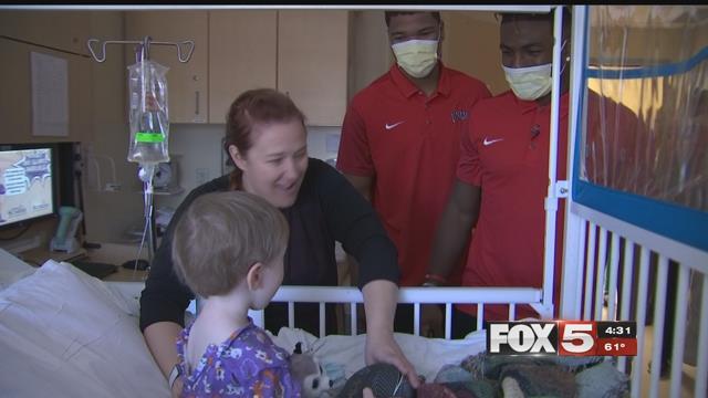 Rebel student-athletes visit children at Sunrise Children's Hospital (FOX5).
