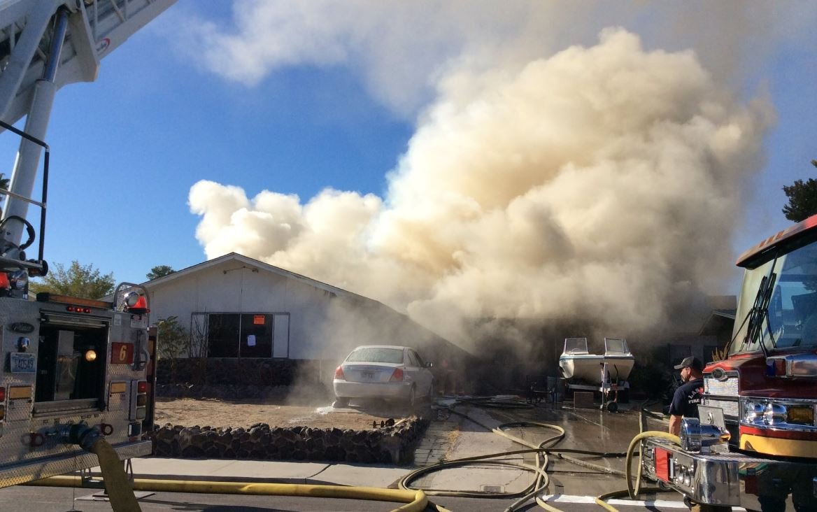 Las Vegas Firefighters at the scene of a house fire on Dec. 13, 2017. (Las Vegas Fire & Rescue)