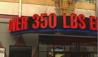 A sign at the entrance encourages diners to eat free if they weigh over 350 pounds