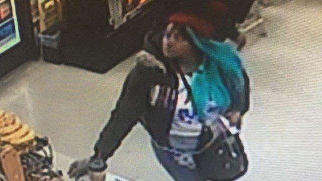 This woman with distinct blue hair grabbed $940 out of a valley woman's hands and ran off.