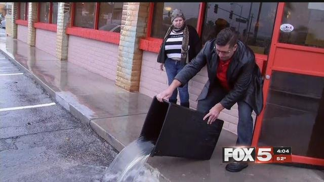 Sergio Perez dumps out a trash can filled with water (FOX5).