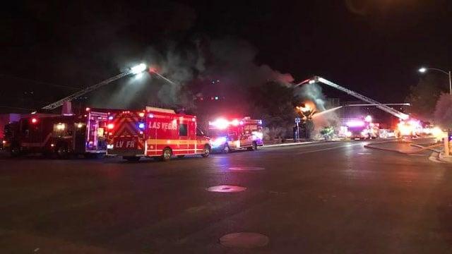Firefighters at the scene of a building fire in downtown Las Vegas on Jan. 14, 2018. (Brad Boyer/FOX5)