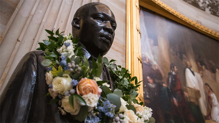 The bust of civil rights activist and leader Martin Luther King Jr. is draped with a wreath of flowers to commemorate his birthday. (AP Photo/J. Scott Applewhite)