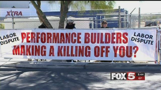 Picketers stand near a Performance Builders job site in Las Vegas (FOX5).