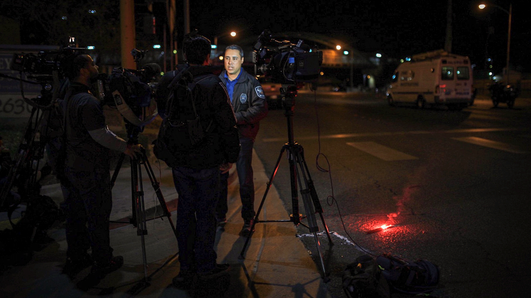 Photojournalists capture an interview with NLVPD Public Information Officer Aaron Patty. (Gai Phanalasy/FOX5)