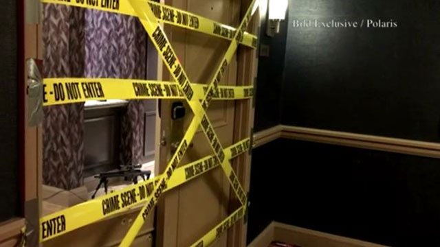 Police tape covers the door of mass shooter Stephen Paddock's suite on the 32nd floor of the Mandalay Bay (FOX5).