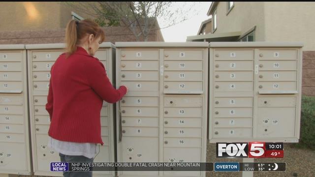 Henderson resident Wanda Sahonyay checks her mailbox (FOX5).