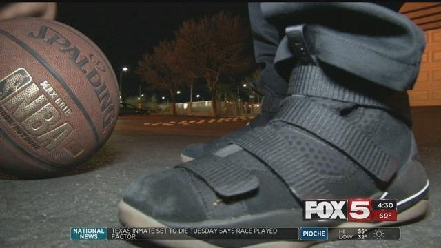 Shawn Elder wears his new shoes and plays with a new basketball (FOX5).