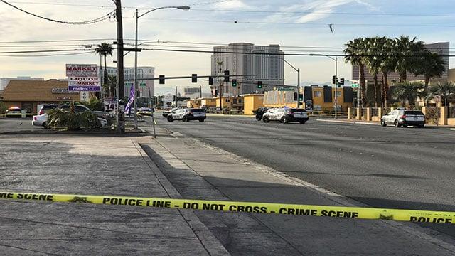 LVMPD patrol vehicles block an intersection where a person was shot (Gai Phanalasy / FOX5).