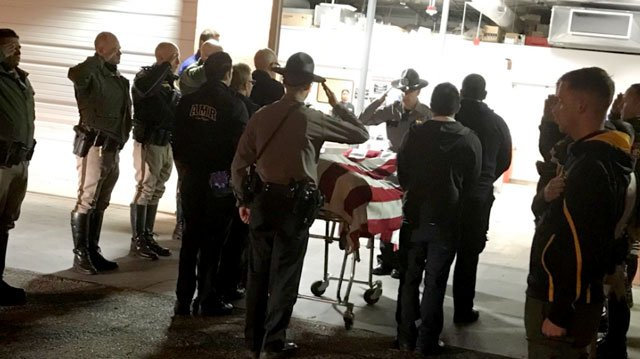 Officials escorted the body of a paramedic to the coroner's office on Feb. 13, 2018. (Source: NHP)