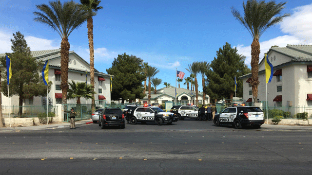 Police vehicles block off the entrance to an apartment complex on Feb. 19, 2018. (Jason Westerhaus/FOX5)