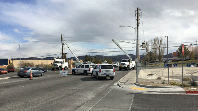 Henderson police block off a roadway as crews work to restore a downed power line on Feb. 19, 2018. (Jason Westerhaus/FOX5)