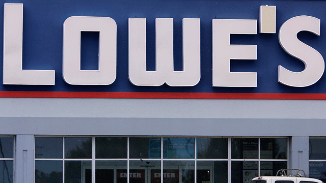 In this file photo taken July 8, 2009, a shopper exits the Lowe's home improvement center in Springfield, Ill. (AP Photo/Seth Perlman, File)