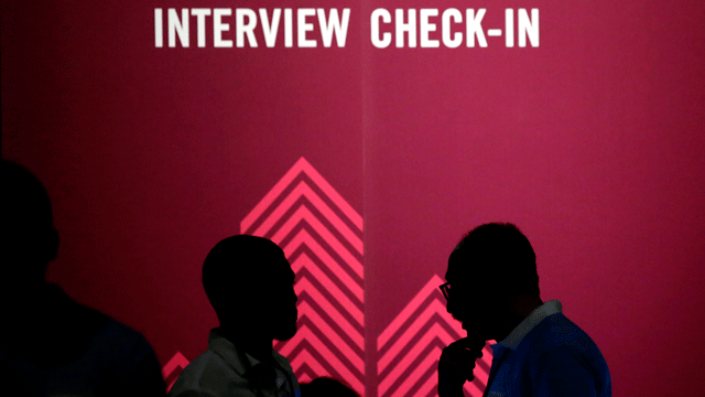In this Friday, May 19, 2017, file photo, job seekers chat during the Opportunity Fair and Forum employment event. (AP Photo/LM Otero, File)