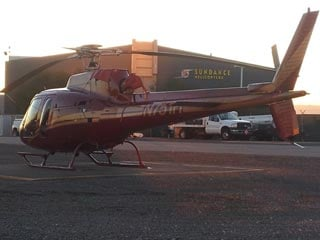A Sundance helicopter sits at the company's headquarters Thursday morning, a day after a fatal helicopter crash near Lake Mead. (Dave Lawrence/FOX5)