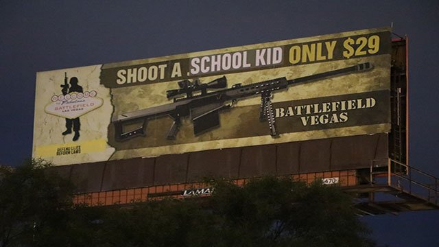 Gun range billboard vandalized with