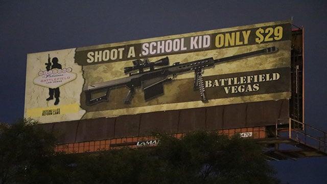 Self-proclaimed activist group 'INDECLINE' vandalized a gun range billboard overnight on March 1, 2018 (INDECLINE / FOX5).