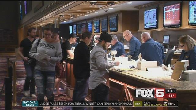 Sports fans placing bets at a Las Vegas sports book. (FOX5)
