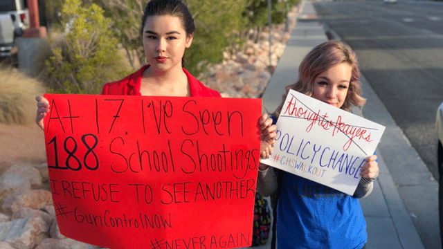 Local students hold signs to show their stance on gun violence. (Dylan Kendrick/FOX5)