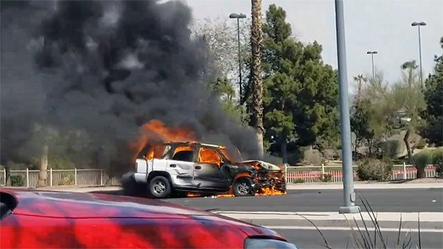 An SUV burst into flames after a 2-vehicle crash in Henderson March 16, 2018 (Steven Juliano / Facebook).
