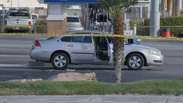 Police tape blocks off a section of a gas station near Russell and Polaris. (Brad Boyer/FOX5)