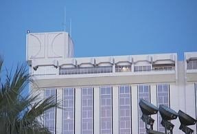 "An outline of the Hilton ""H"" symbol is all that remains on the building's exterior"