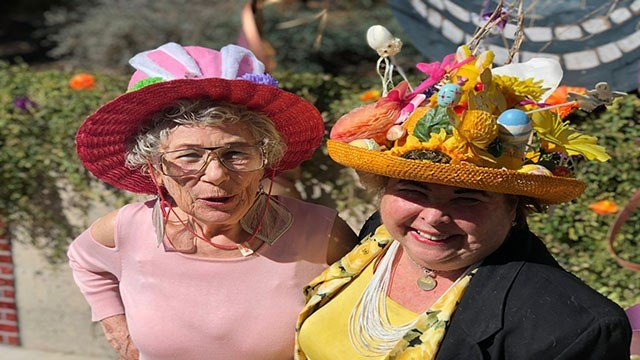 Two women wore festive hats to the 'Mad Hatter Egg Hunt' March 29, 2018 (Dylan Kendrick / FOX5).