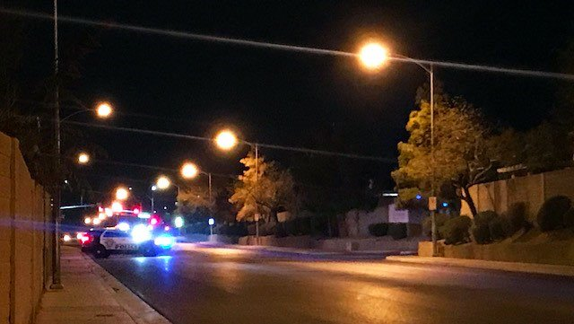 A LVMPD patrol unit blocks Treeline Drive as officers search for the alleged carjacking suspects (Jenn Hurtado / FOX5).
