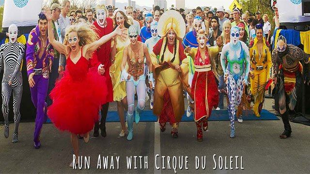 Cirque du Soleil performers launch from the start line at the annual fun walk and 5K (Springs Preserve).