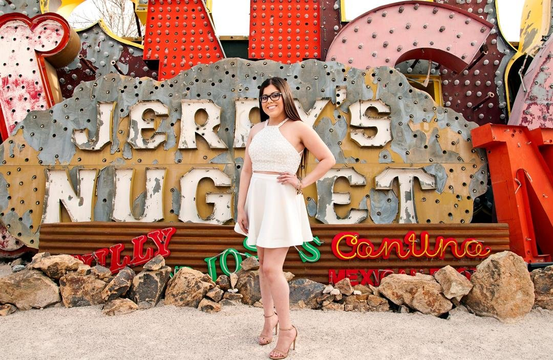 A girl poses in front of a sign at the Neon Museum. (Source: Neon Museum)