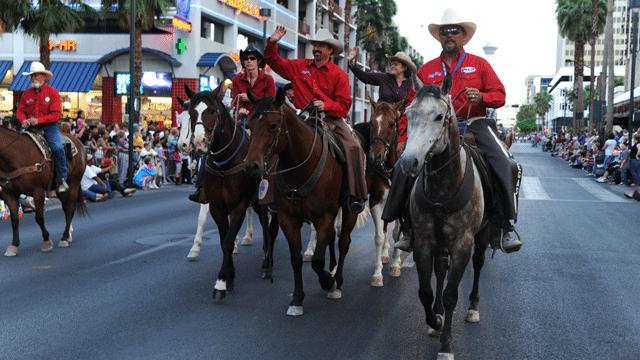 A group marches in the parade. (Source: Helldorado Parade)