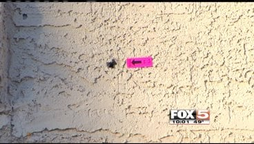 A bullet hole is left on a home where a shooting happened in the northeast end of Las Vegas.