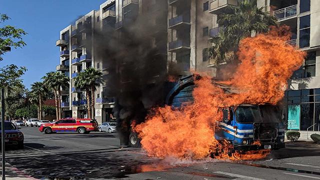 A Republic Services garbage truck caught fire in downtown Las Vegas April 14, 2018 (LVFR).