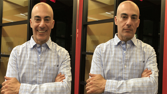 Mike Doria demonstrates the effects of smiling and frowning in photos. (Mike Doria/FOX5)