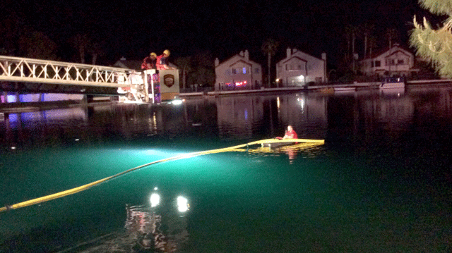 Firefighters rescued a couple from the rooftop of a car submerged in a lake on April 17, 2018. (Source: LVFR)