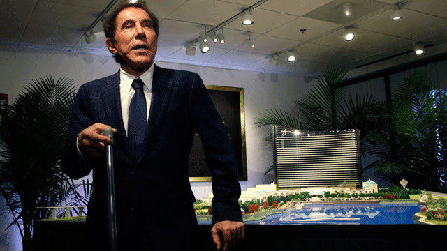 """Casino mogul Steve Wynn holds a cane as he rests against a site model during a news conference regarding his proposed $1.7 billion casino complex, tentatively named """"Wynn Boston Harbor"""", in Medford, Mass., Tuesday, March 15, 2016. (AP Photo/Charles Krupa)"""