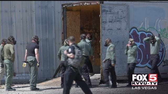 An AMR tactical team practices through a training course (FOX5).
